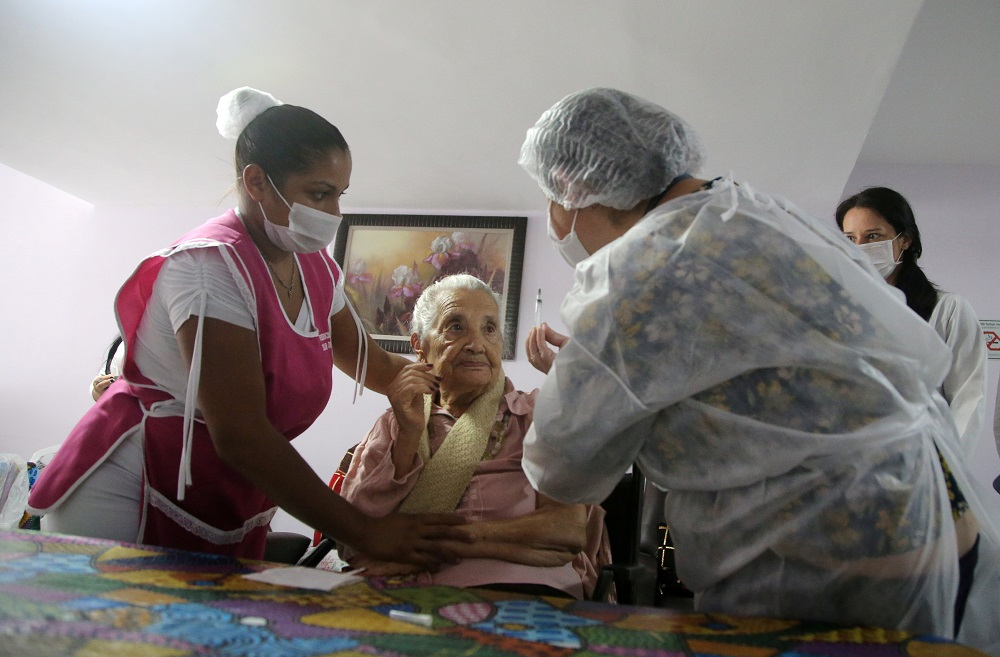 A health worker prepares to apply the second dose of Sinovac's CoronaVac coronavirus disease vaccine to an elderly citizen at Solar das Acacias nursing home, in Guarulho near Sao Paulo February 26, 2021. — Reuters pic