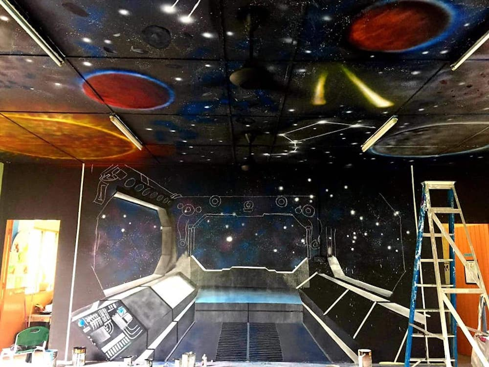 Once the ceiling was done, Cikgu Farra began working on the spaceship detailing on the walls. — Picture via Facebook/Cikgu Farra.