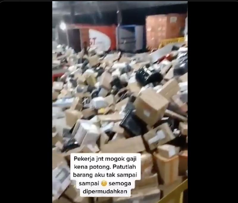The viral video showed J&T workers roughly handling parcels in a warehouse in Perak. — Screenshot via Twitter/@ixzulazim