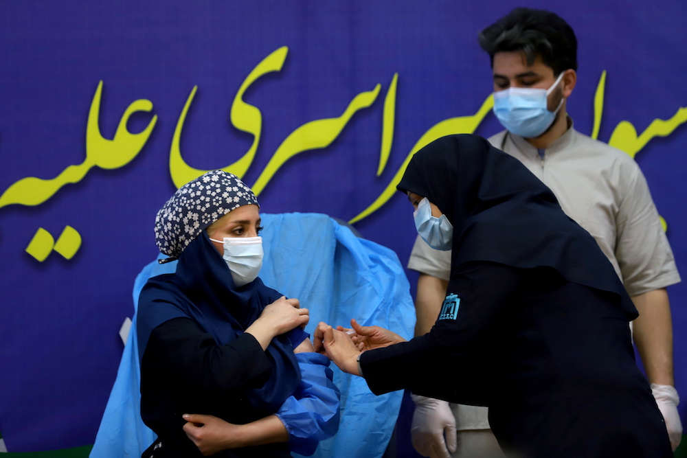 A member of the Imam Khomeini Hospital medical personnel receives a dose of Russia's Sputnik V vaccine against the coronavirus disease (Covid-19), in Tehran, Iran February 9, 2021. — Majid Asgaripour/WANA (West Asia News Agency) via Reuters pic