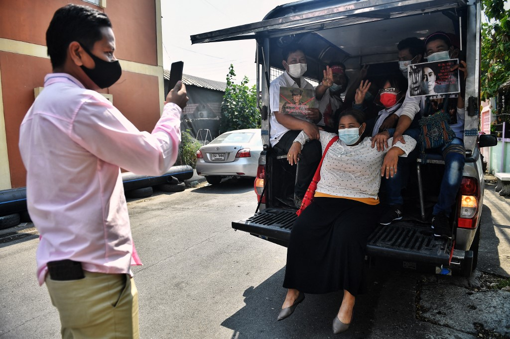 This photo taken on February 7, 2021, shows business owner 'Pu', and fellow Myanmar migrants in the back of a truck before going to a local protest against the military coup in their home country, in Bangkok. — AFP pic