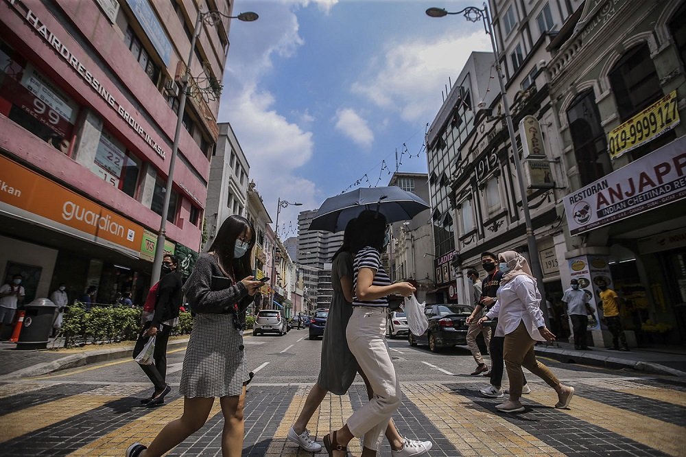 People were face masks during the movement control order, in Kuala Lumpur city centre February 16, 2021. — Picture by Hari Anggara