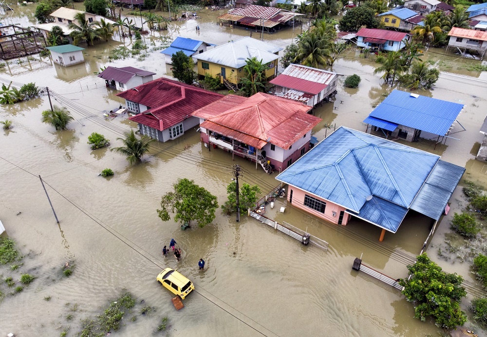 An aerial view of some of houses affected by the flood in Kuching February 19, 2021. — Bernama pic