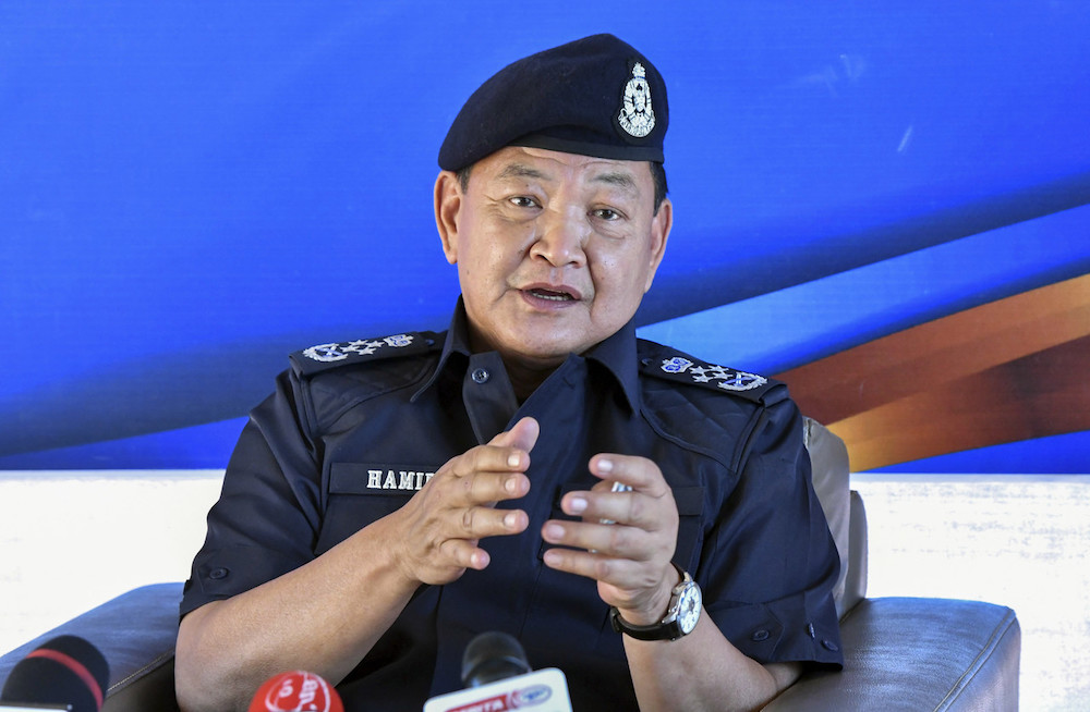 Inspector-General of Police Tan Sri Abdul Hamid Bador Tan Sri Abdul Hamid Bador speaks to media after visiting the construction site for the new Jeli District police headquarters in Jeli, Feb 27 2021. — Bernama pic