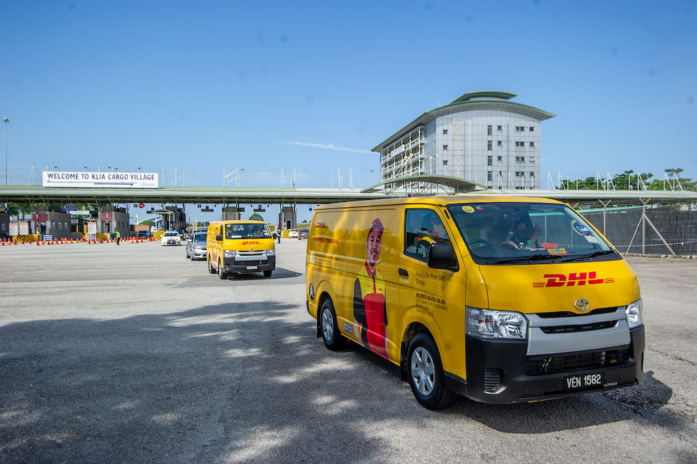 A convoy of DHL Express vehicles carry the first batch of Pfizer-BioNTech's Covid-19 vaccine with police escort from Cargo Village in KLIA, February 21, 2021. — Picture by Shafwan Zaidon