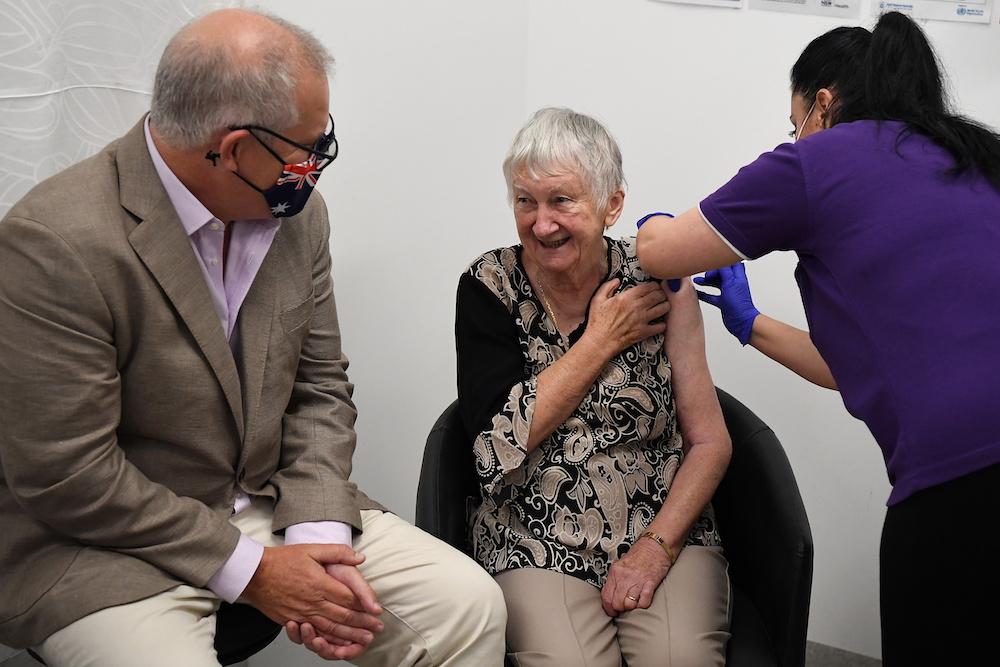 Australian Prime Minister Scott Morrison joins aged care resident Jane Malysiak as she receives the first Covid-19 vaccine in Sydney February 21, 2021. — AAP Image/Joel Carrett handout via Reuters