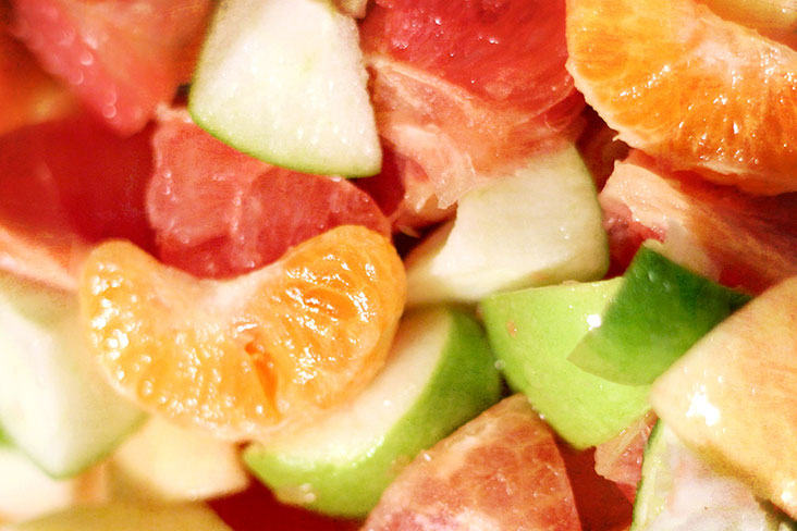 The base of the salad – mandarin oranges and other fruits.