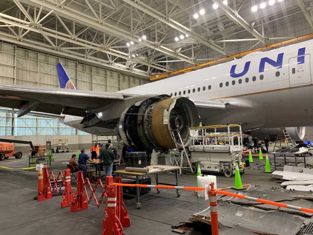 The damaged starboard engine of United Airlines flight 328, a Boeing 777-200, is seen following a February 20 engine failure incident, in a hangar at Denver International Airport in Denver, Colorado, US, February 22, 2021. — National Transportation Safety Board handout pic via Reuters