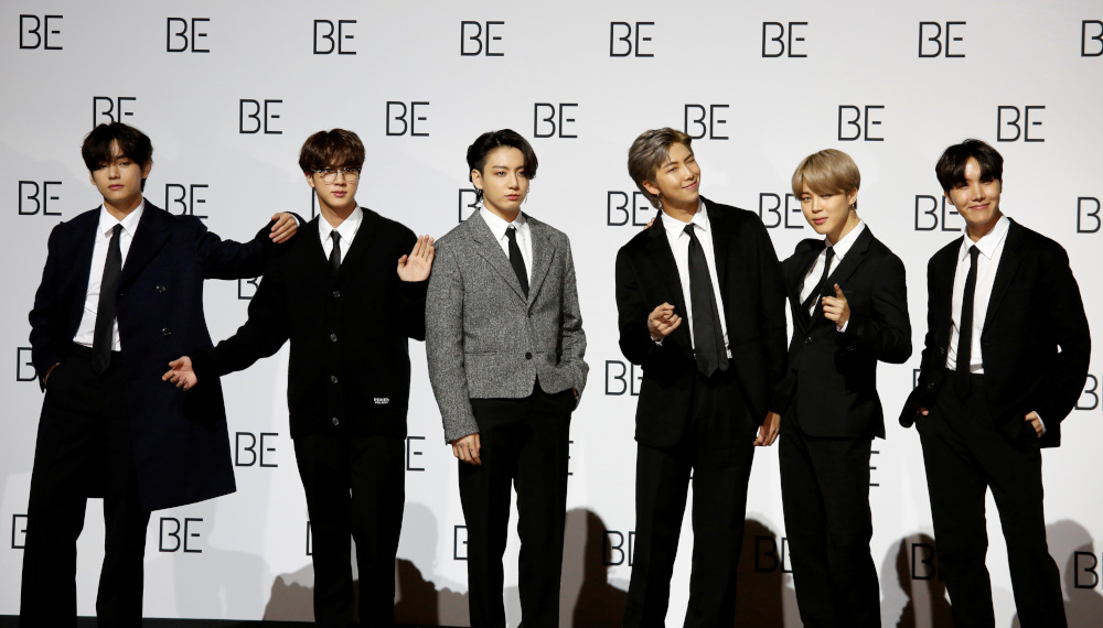 Members of K-pop boy band BTS pose for photographs during a news conference promoting their new album 'BE (Deluxe Edition)' in Seoul, South Korea, November 20, 2020. — Reuters pic