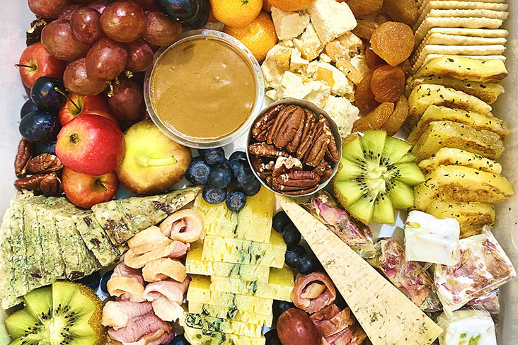 The Aventuriere Cheese Box contains six gourmet artisan cheeses and an assortment of other goodies.