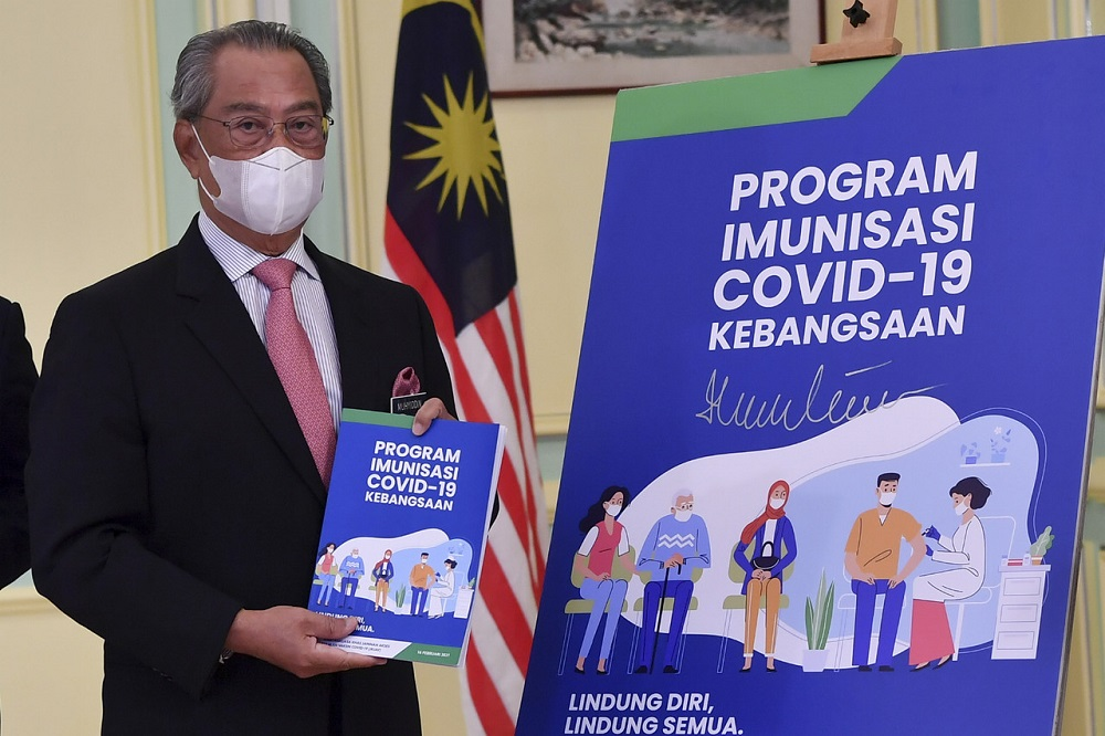 Prime Minister Tan Sri Muhyiddin Yassin at the launch of the National Covid-19 Immunisation Programme Handbook in Putrajaya February 16, 2021. — Bernama pic