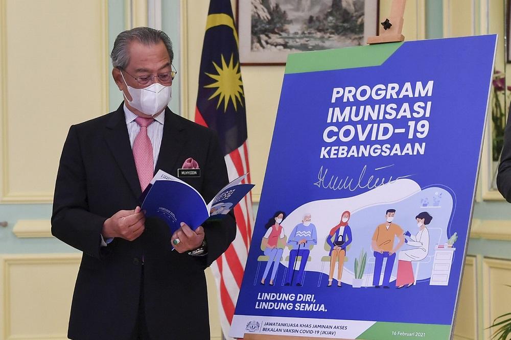 Prime Minister Tan Sri Muhyiddin Yassin at the launch of the National Covid-19 Immunisation Programme Handbook at the Perdana Putra Building in Putrajaya February 16, 2021. — Bernama pic