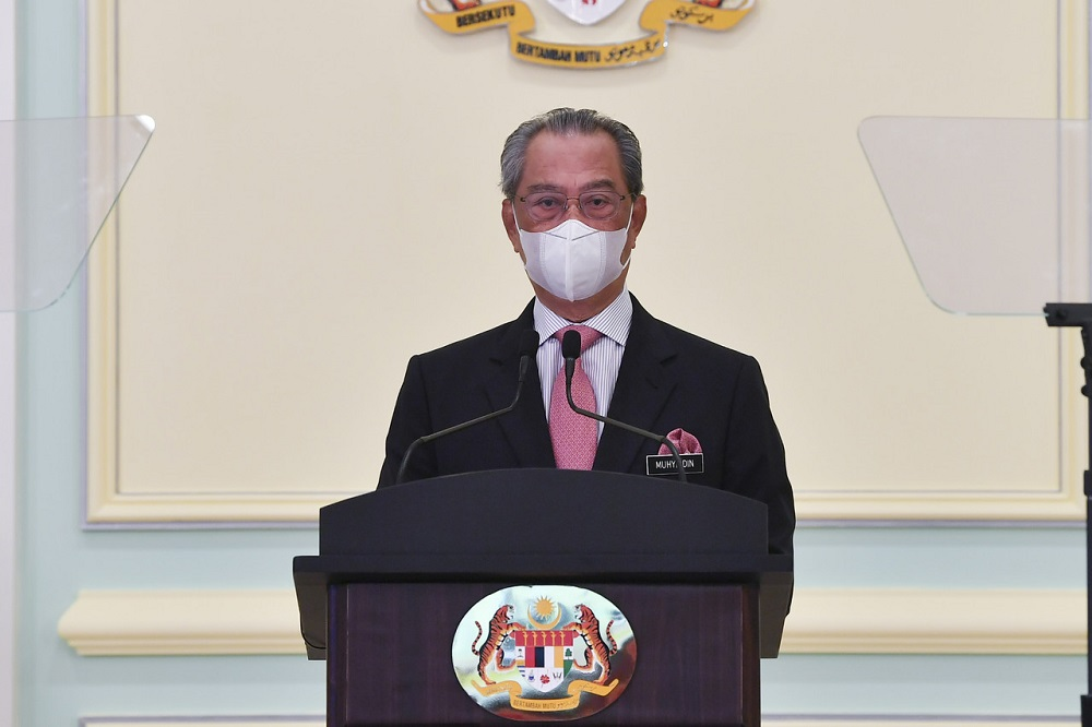Prime Minister Tan Sri Muhyiddin Yassin delivers a speech at the launch of the National Covid-19 Immunisation Programme Handbook at the Perdana Putra Building in Putrajaya February 16, 2021. — Bernama pic