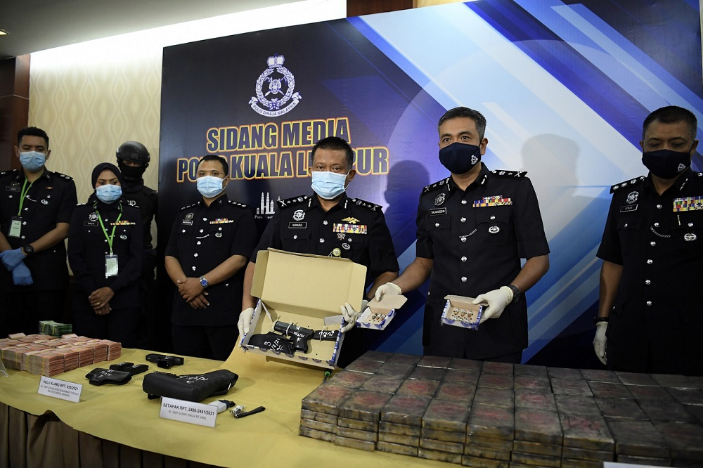 Bukit Aman Narcotics Criminal Investigation Department deputy director (Forfeiture of Property/Legal/Detention) Datuk Kamarul Zaman Mamat (third right) during a press conference in Kuala Lumpur February 23, 2021. — Bernama pic