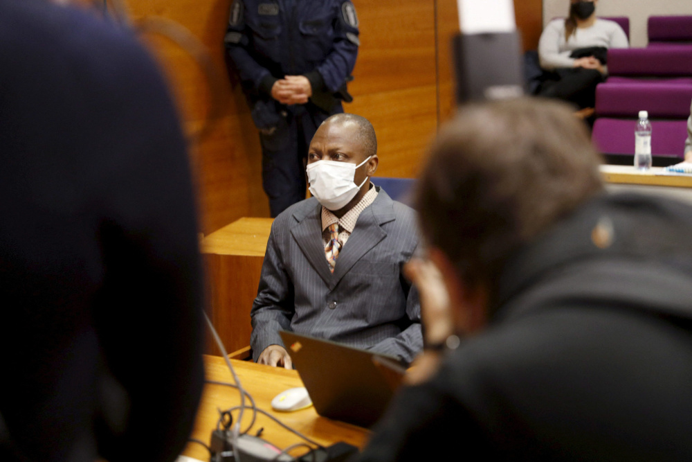 In this file photograph taken February 3, 2021, Sierra Leonean national Gibril Massaquoi attends the first day of his trial at The Pirkanmaa District Court in Tampere, Finland. — AFP pic