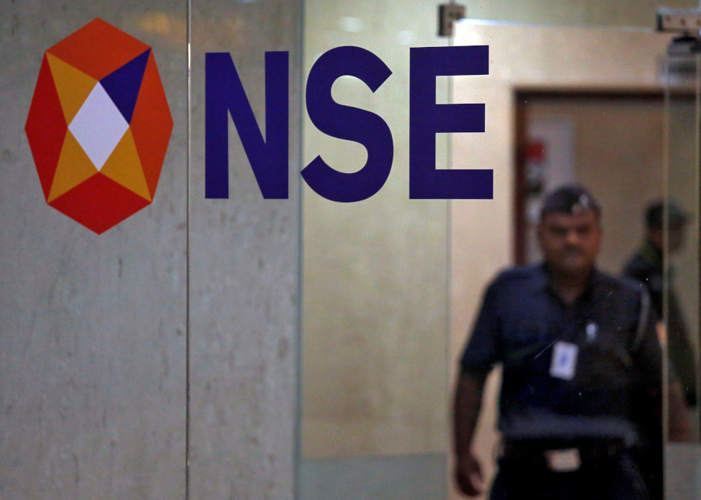 A security guard walks past the logo of the National Stock Exchange (NSE) inside its building in Mumbai, India, May 28, 2019. — Reuters pic