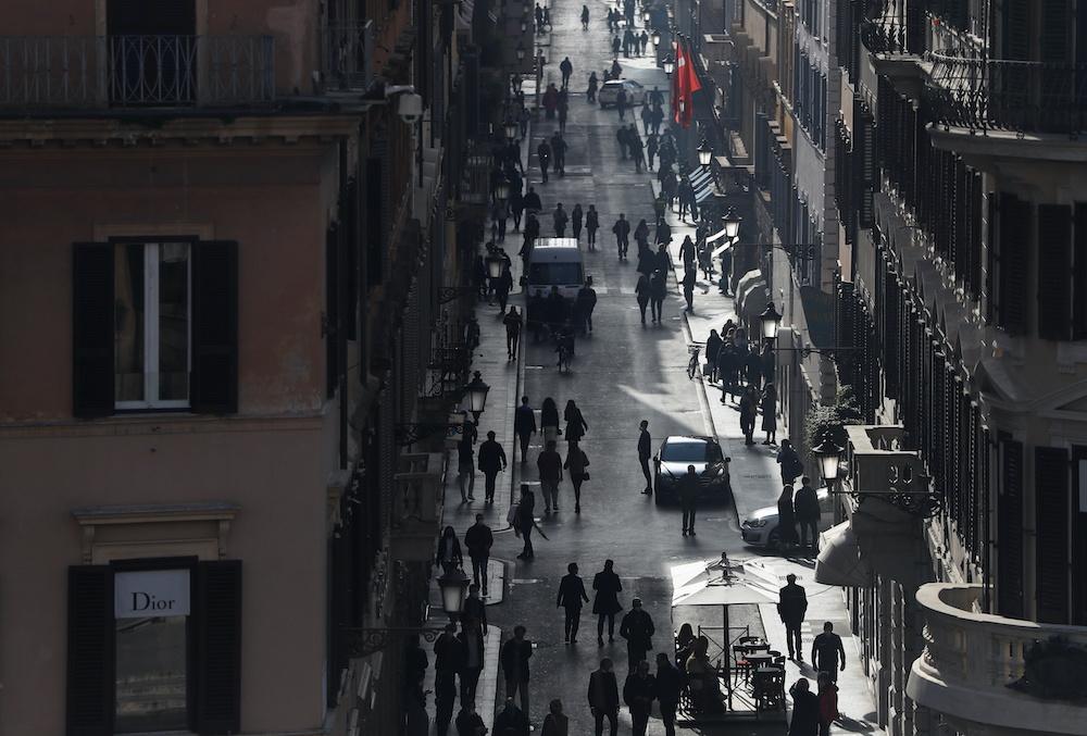 People walk along Via dei Condotti amid the coronavirus disease outbreak in Rome, Italy, February 26, 2021.— Reuters pic