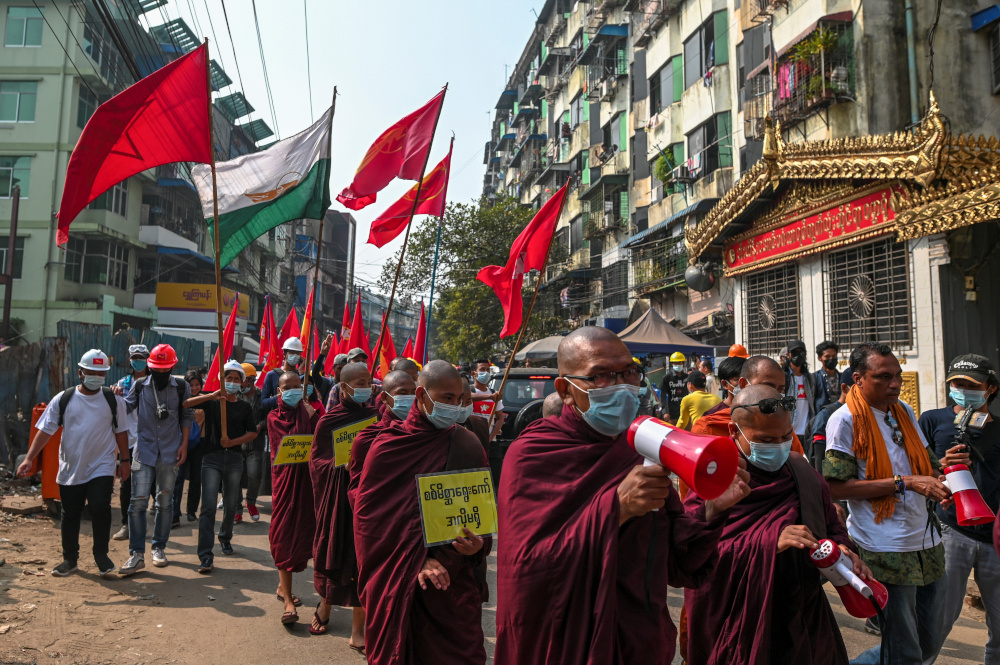 Buddhist monks and demonstrators rally against the military coup and to show their support to local residents after riot police officers used teargas to disperse a crowd in Yangon's Tamwe neighbourhood, Myanmar, February 26, 2021. — Reuters pic