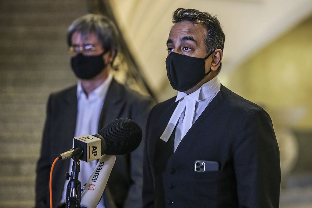Malaysiakini's lead counsel Datuk Malik Imtiaz Sarwar speaks to reporters at the Federal Court in Putrajaya February 19, 2021. ― Picture by Hari Anggara