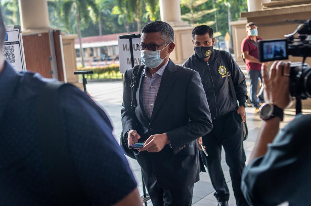 Former 1Malaysia Development Bhd (1MDB) chief executive officer Mohd Hazem Abdul Rahman arrives at the Kuala Lumpur Court Complex February 15, 2021. — Picture by Shafwan Zaidon