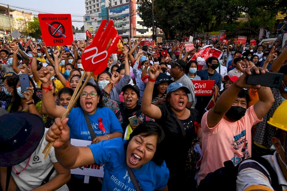 Protesters take part in a demonstration against the military coup in front of the National League for Democracy (NLD) office in Yangon on February 15, 2021. — AFP pic