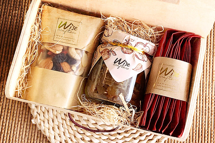 The Wise Crafters CNY Treasure Box contains spiced apple chutney, healthy snacks and osmanthus oolong tea. – Picture courtesy of Wise Crafters