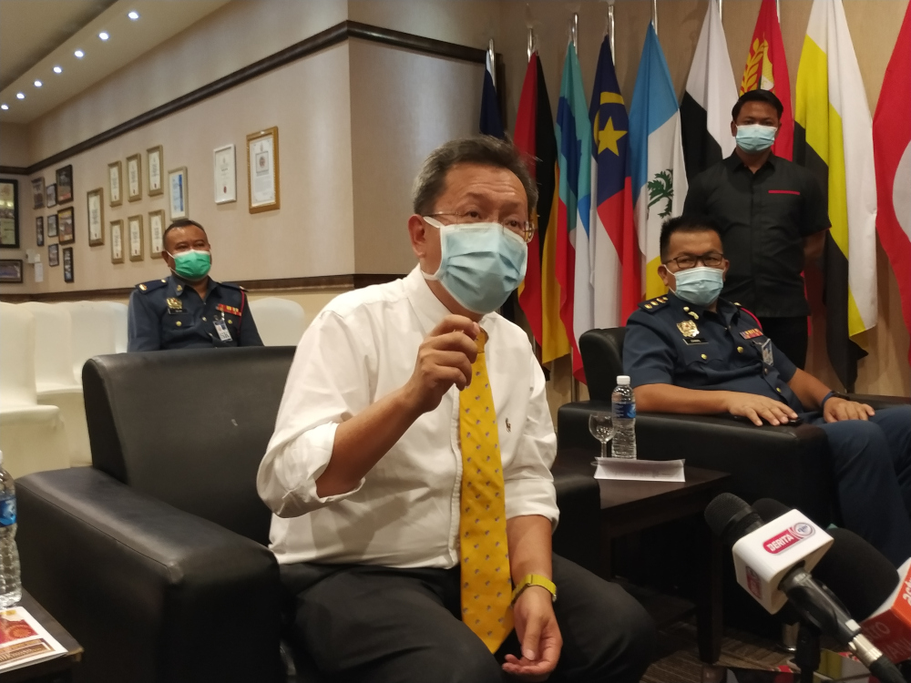 Sarawak Minister of Local Government and Housing Datuk Seri Dr Sim Kui Hian said this could be achieved as Sarawak should be able to vaccinate 50,000 people per day, with about one million in June and another one million in July. — Picture by Sulok Tawie