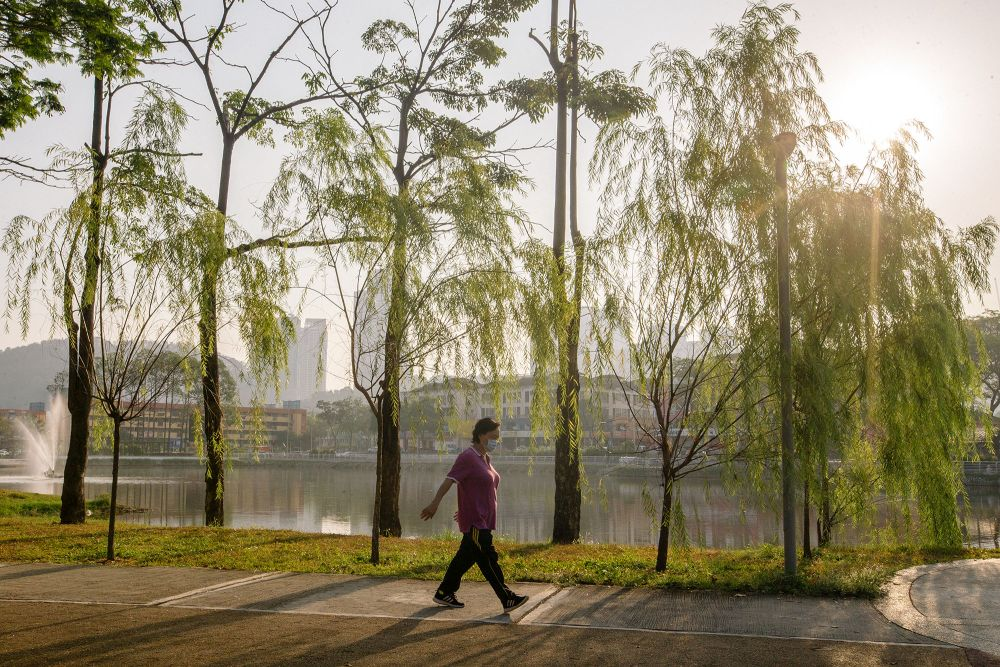 A woman is seen taking a walk at the Sri Rampai Lake Park in Kuala Lumpur February 24, 2021. — Picture by Firdaus Latif