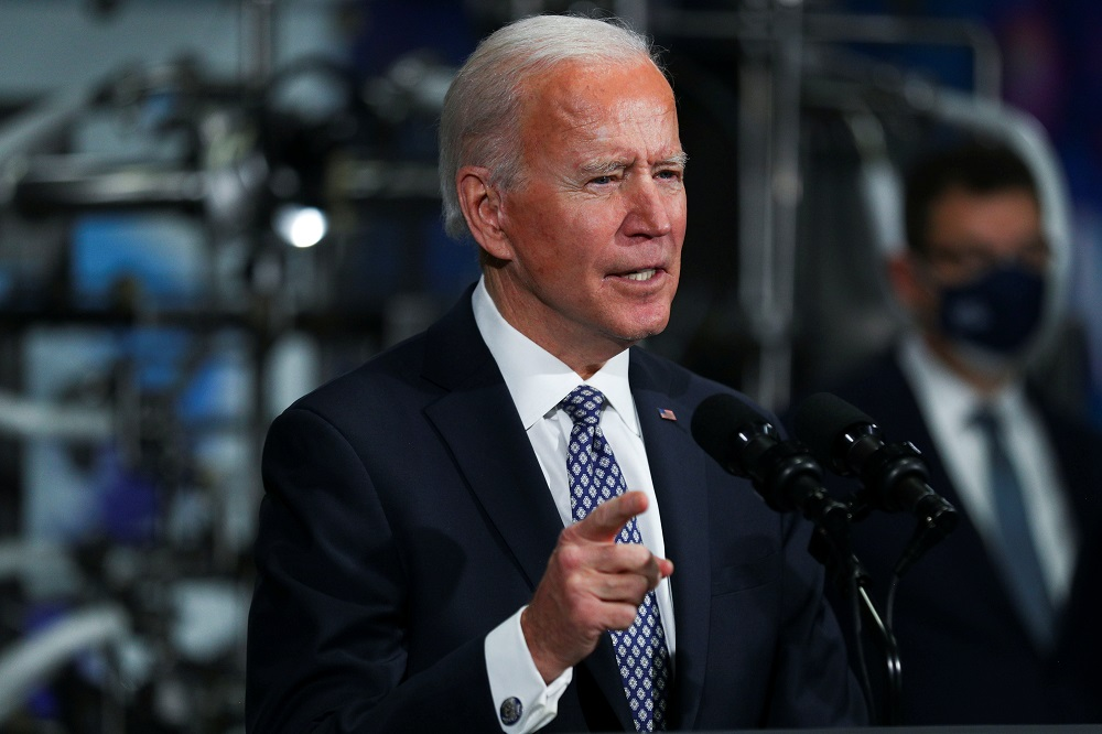 US President Joe Biden speaks after a tour of a Pfizer manufacturing plant producing the Covid-19 vaccine in Kalamazoo, Michigan February 19, 2021. ― Reuters pic