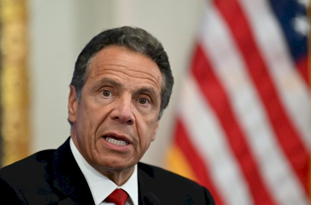 New York Governor Andrew Cuomo has denied any wrongdoing, though he has acknowledged it had been a 'custom' for him to kiss and hug people when greeting them. — AFP pic