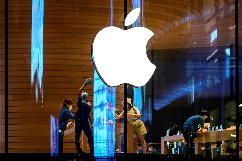 The Apple logo is seen on a window of the company's store in Bangkok. ― AFP pic