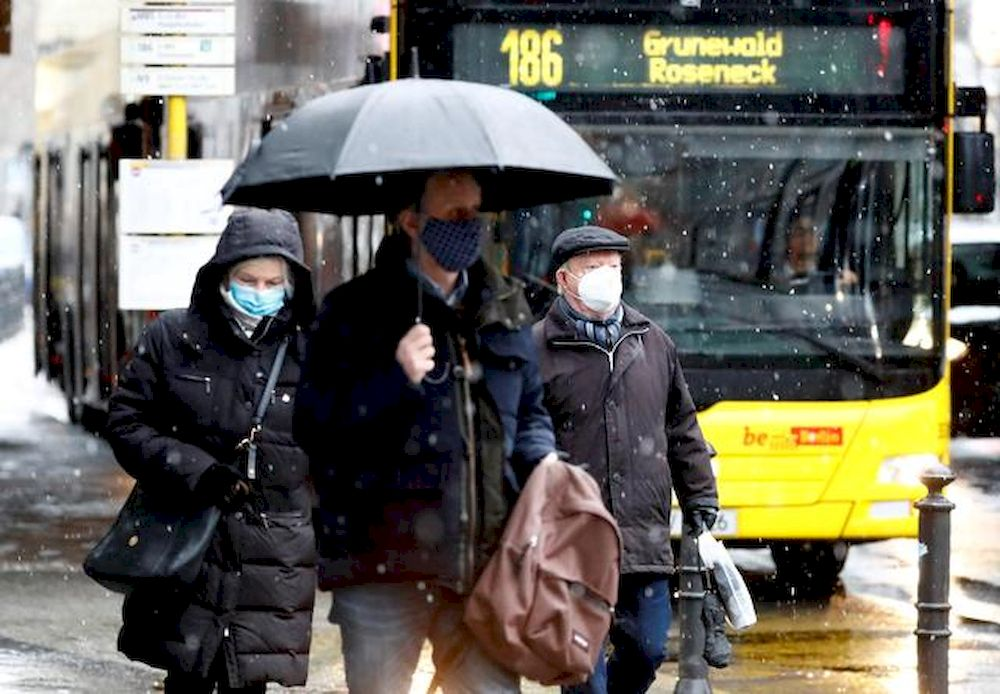 People wear face masks as they walk past a bus during lockdown due to the coronavirus disease (Covid-19) pandemic in Berlin, Germany, January 19, 2021. — Reuters pic