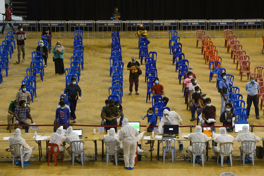 Patients gather at Covid-19 Assessment Centre (CAC) in Stadium Melawati Shah Alam February 8, 2021. Dr Hishamshah Mohd Ibrahim said currently, the rising new cases in the country were due to new variants such as the Delta variant. — Picture by Miera Zulyana