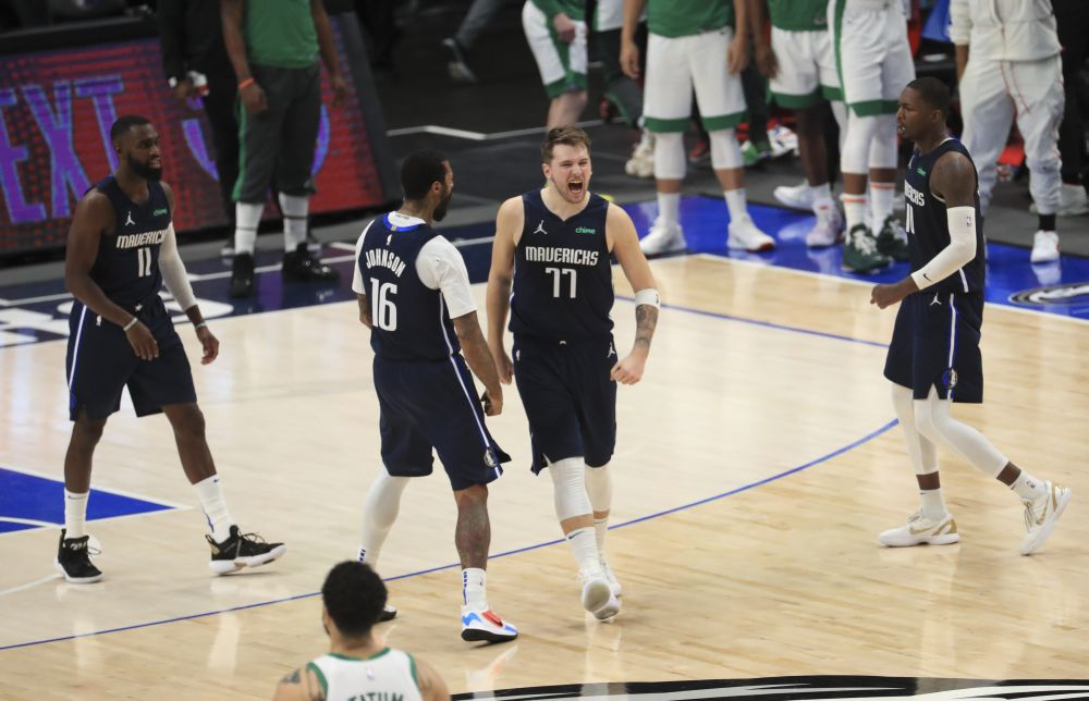 Dallas Mavericks guard Luka Doncic (77) celebrates with forward James Johnson (16) after hitting the game-winner against the Boston Celtics during the fourth quarter at American Airlines Centre February 23, 2021. ― Reuters pic