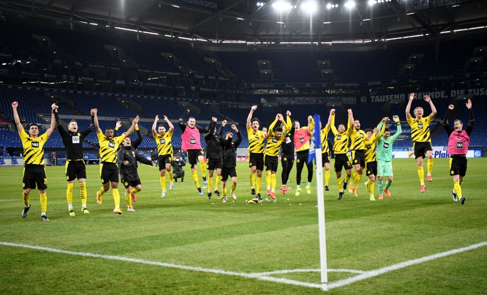 Borussia Dortmund players celebrate after the match against Schalke at the Veltins-Arena, Gelsenkirchen February 20, 2021. — Reuters pic
