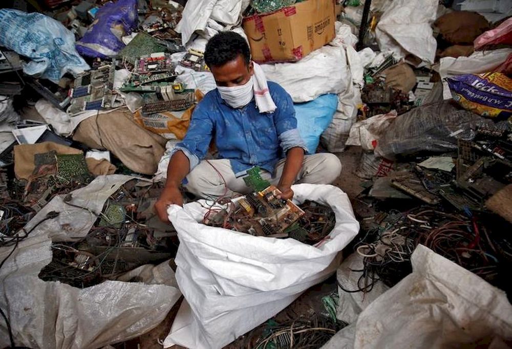 File picture shows a scrap dealer sorting dismantled TV circuit boards at a scrap yard in Ahmedabad, India, July 2, 2020. — Reuters pic