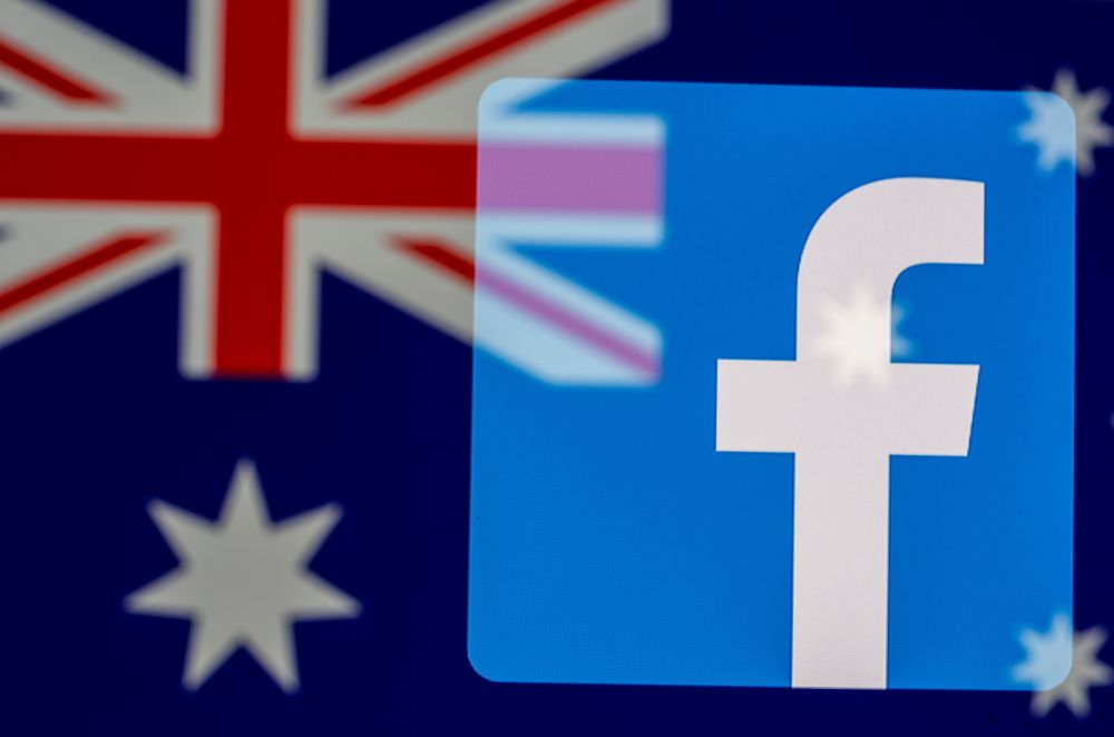 Facebook logo and Australian flag are displayed in this illustration taken February 18, 2021. — Reuters pic