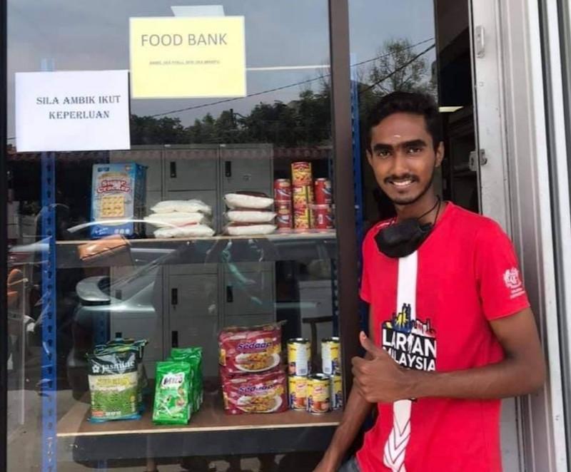 R. Praviin has set up two food banks, one each at Teluk Kemang and Taman Mewah in Port Dickson to help poor families. — Picture from Facebook/ Negeri Sembilan Kini