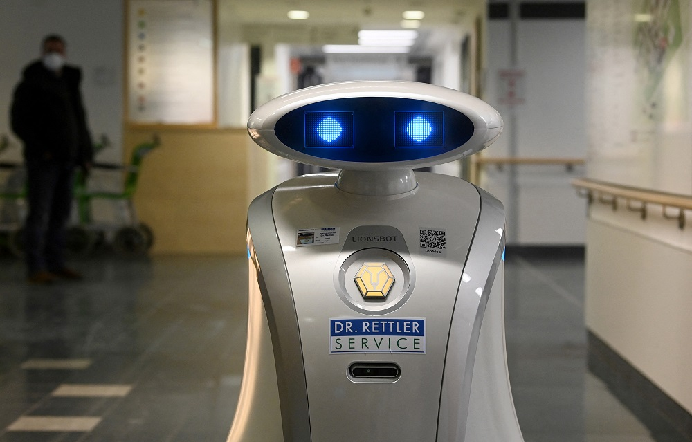 Cleaning robot 'Franzi' cleans in the entrance area of a hospital in Munich Neuperlach, southern Germany. ― AFP pic via ETX Studio