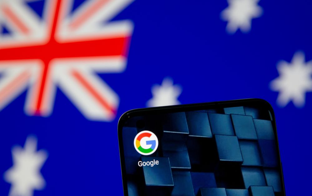 A smartphone with a Google app icon is seen in front of the displayed Australian flag in this illustration, January 22, 2021. — Reuters pic