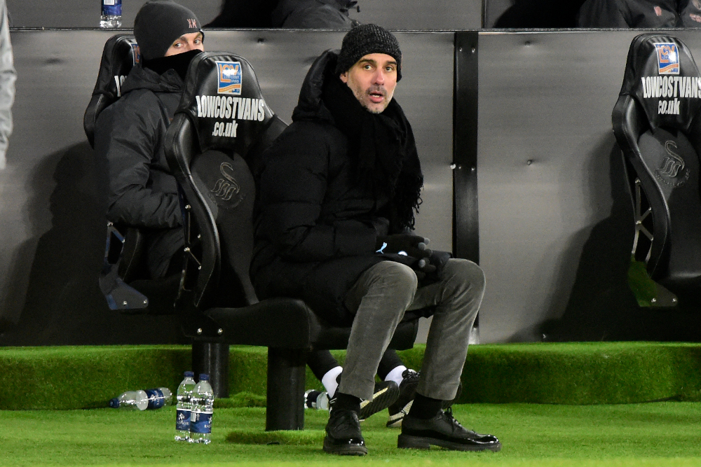 Manchester City manager Pep Guardiola looks on during the English FA Cup fifth round football match between Swansea and Manchester City at the Liberty Stadium in Swansea, Wales February 10, 2021. — AFP pic