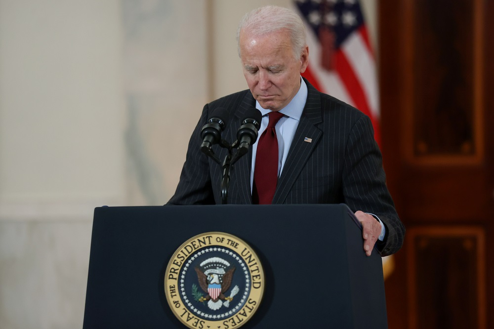US President Joe Biden concludes his remarks in honour of the 500,000 deaths from the coronavirus disease, in the Cross Hall at the White House in Washington February 22, 2021. ― Reuters pic