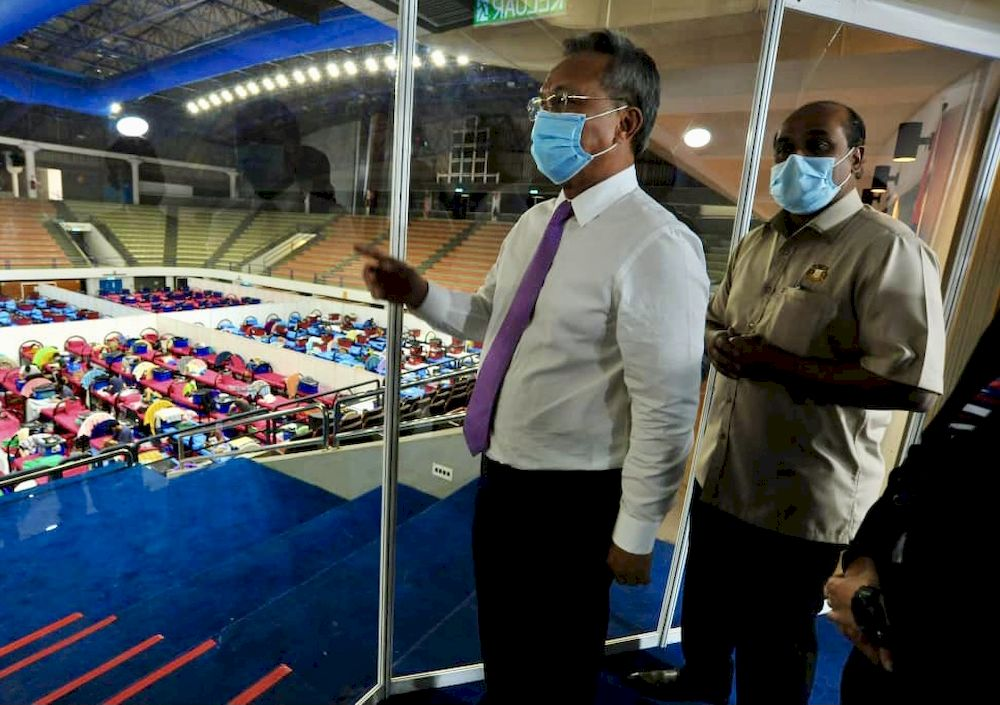Johor MB Datuk Hasni Mohammad (left) and Johor Health and Environment Committee chairman R. Vidyananthan on their visit to the Covid-19 Quarantine and Treatment Centre at the Pasir Gudang City Council Indoor Stadium today. — Picture by Ben Tan