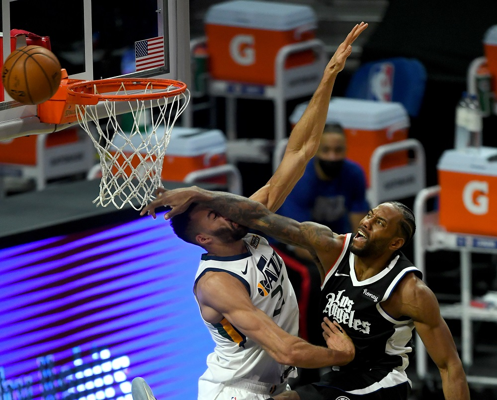 Los Angeles Clippers forward Kawhi Leonard (2) is charged with an offensive foul as he goes up for a dunk over Utah Jazz centre Rudy Gobert (27) at Staples Center. ― Jayne Kamin-Oncea-USA TODAY Sports pic via Reuters