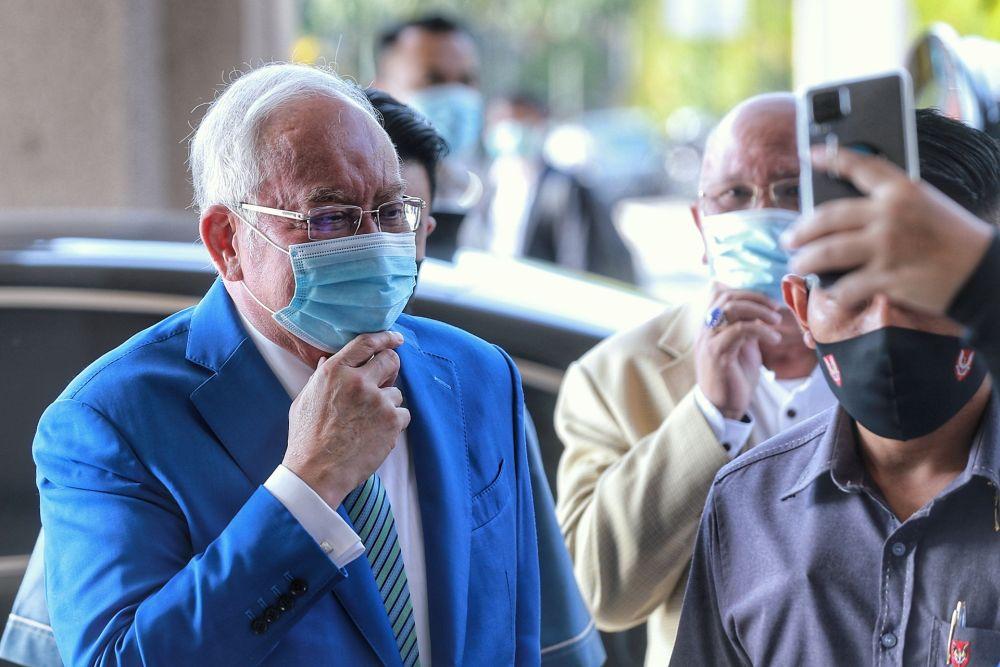 Datuk Seri Najib Razak arrives at the Kuala Lumpur High Court February 23, 2021. — Picture by Ahmad Zamzahuri