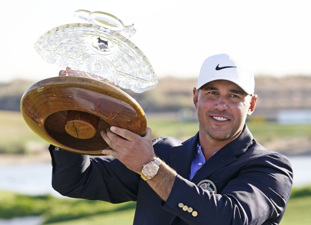 Brooks Koepka poses with the trophy after winning the Waste Management Phoenix Open at TPC Scottsdale, Arizona February 7, 2021. — Reuters pic
