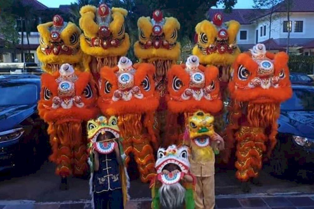 Yun Yang Dragon And Lion Dance Association, usually hired to do caiqing at about 100 places a year, received fewer than 10 bookings this year. — TODAY file pic
