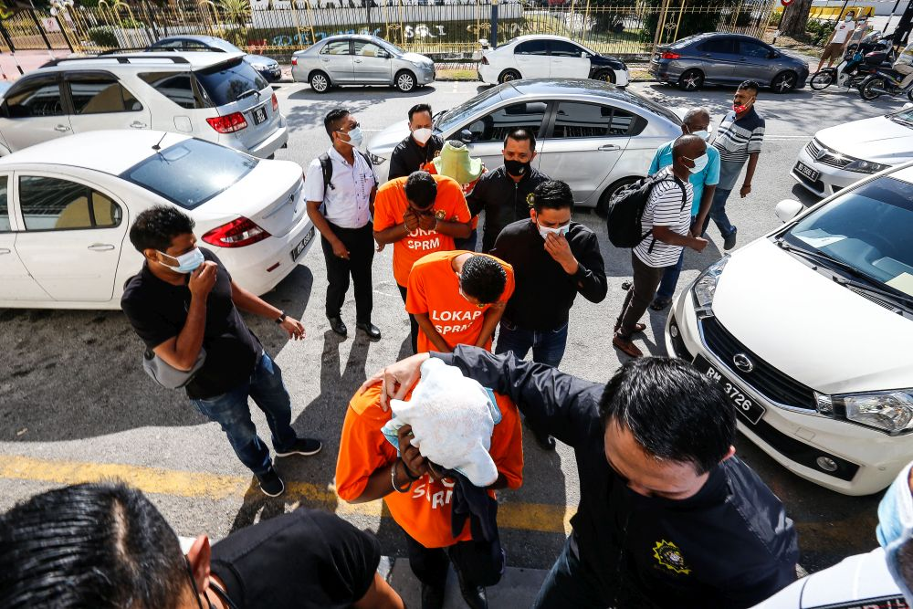 Two cops, Penang council worker, and businessman under MACC remand over RM500,000 graft case