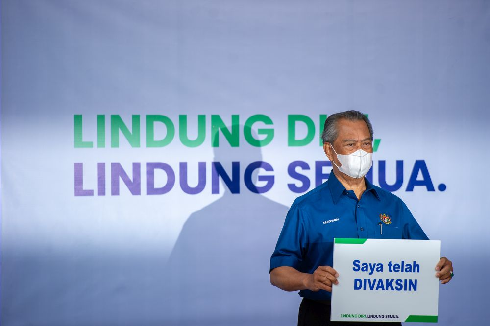Prime Minister Tan Sri Muhyiddin Yassin poses for the cameras after receiving his jab during the launch of the National Covid-19 Immunisation programme in Putrajaya February 24, 2021. ― Picture by Shafwan Zaidon