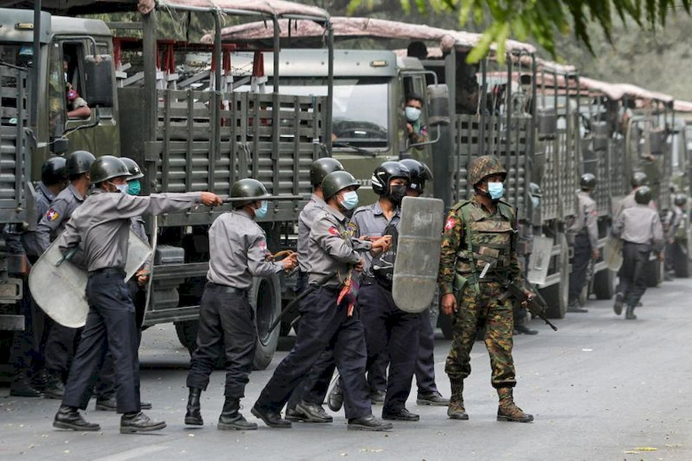 Police and soldiers are seen during a protests against the military coup, in Mandalay, Myanmar, February 20, 2021. — Reuters pic